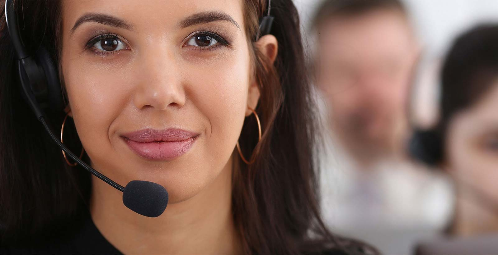 Vision voice & data 3 call centre service operators at work smiling woman at workplace